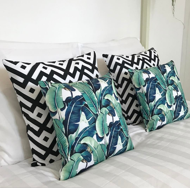 Scatter pillows from RedBubble, Zara bed linen, tropical boho master bedroom