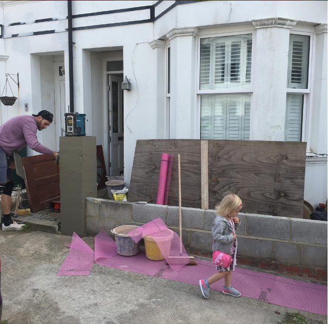 Ryan Magee plastering the front of our Victorian house in Hove, East Sussex