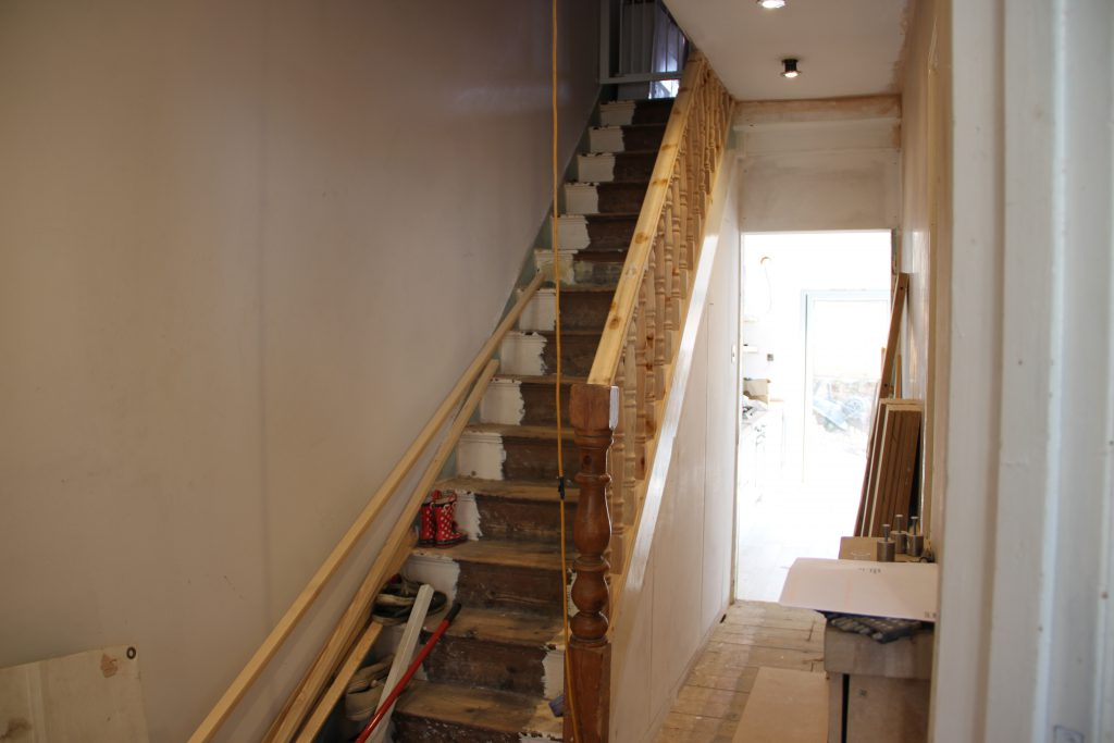staircase renovation replacing spindles and bannister rail