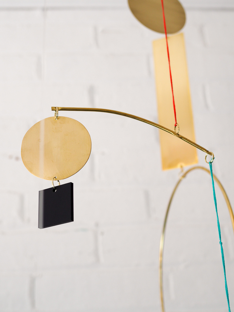 brass and acrylic geometric hanging mobile