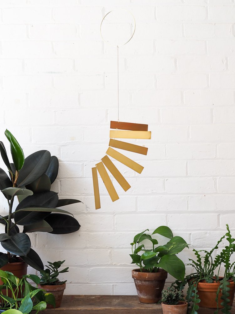 Moving brass hanging mobile Spiral