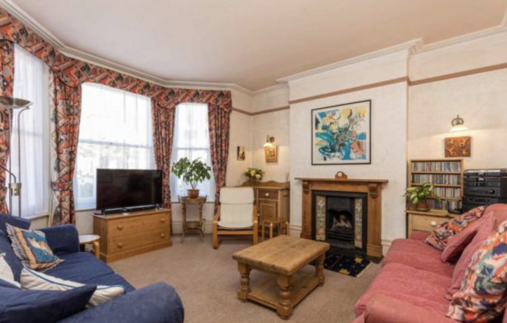 Dated living room in need of modernisation Edwardian semi in Hove